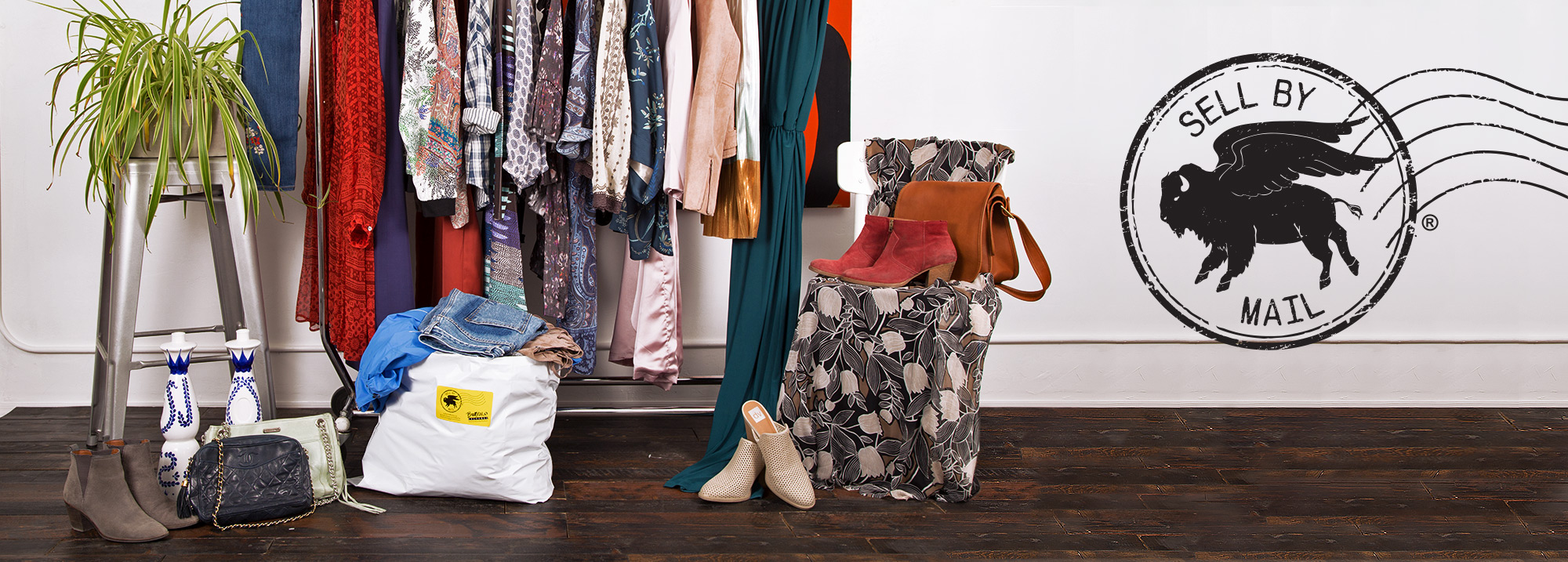 Sell by mail header image with bag of clothing and clothing on a rack